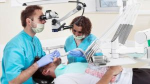 Dentist Adrian Przewoski during the root canal treatment